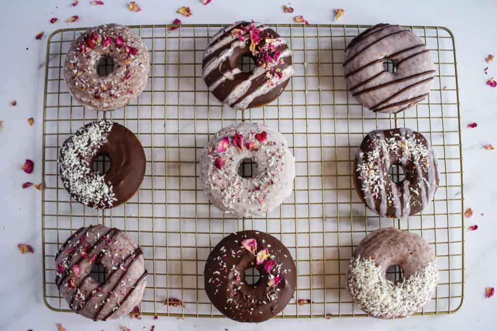 glazed vegan donuts on a drying rack