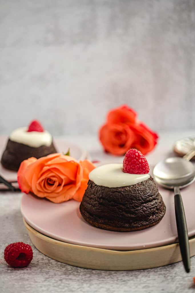 lava cake on pink plate with whipped cream and roses