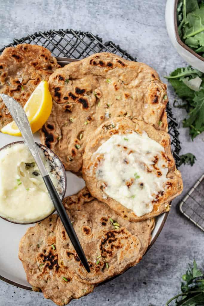 scallion pancakes slathered with garlic sauce and lemon