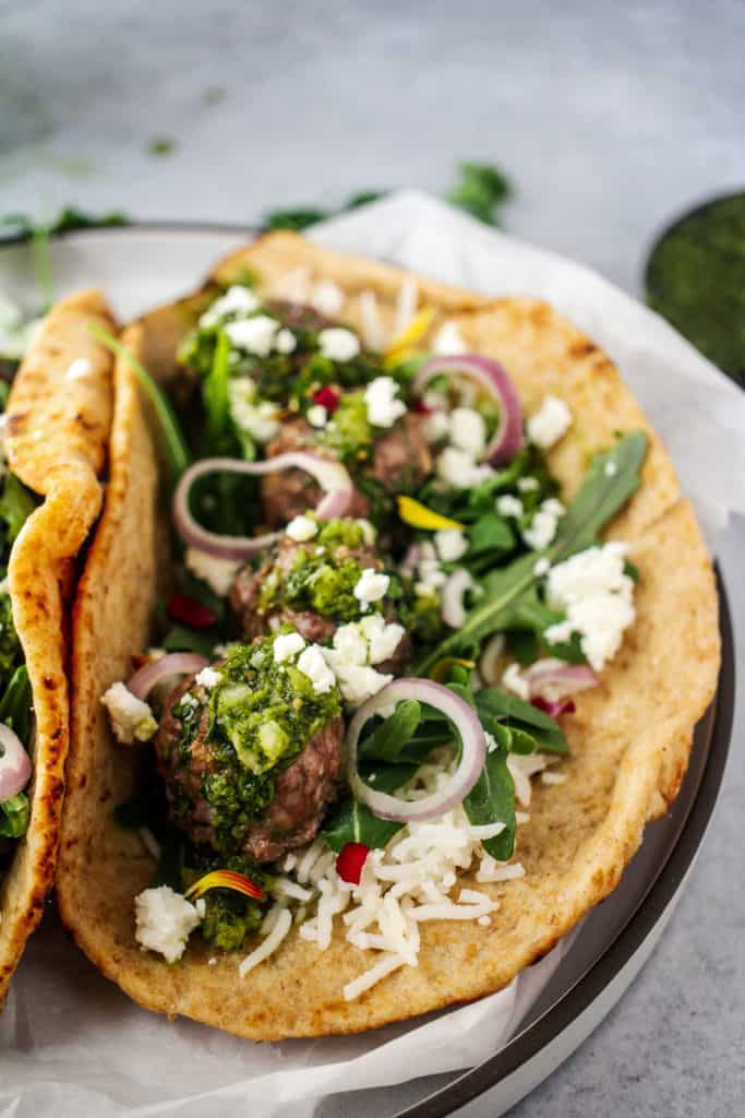 pita wrap stuffed with rice, greens, chimichurri and lamb meatballs