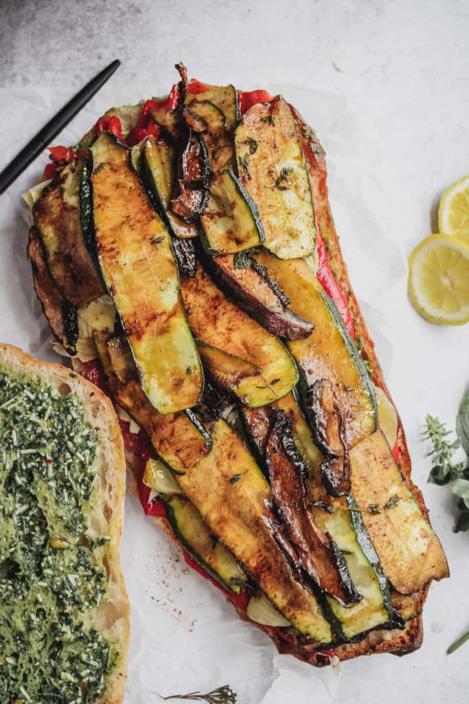 open face sandwich with roasted zucchini, peppers and mushrooms with pesto