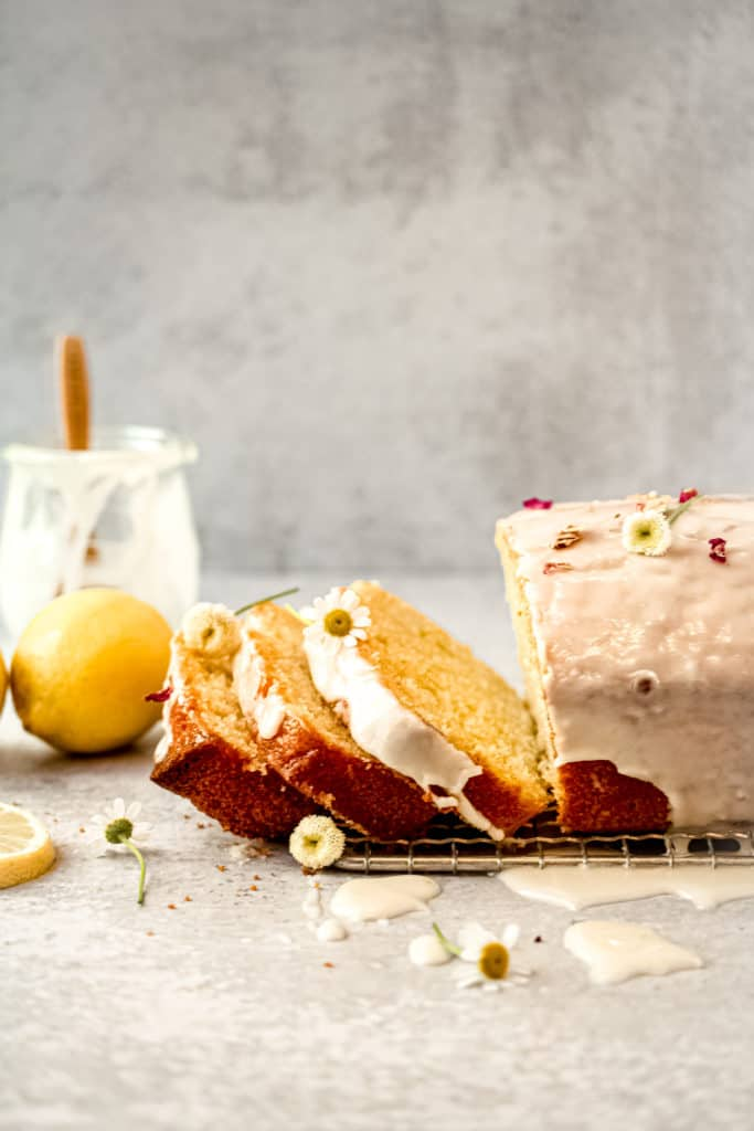 Lemon loaf with lemon icing with 3 slices