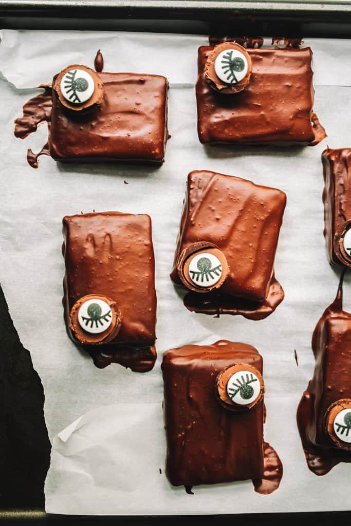 Chocolate Iced Brownies drying on parchment paper