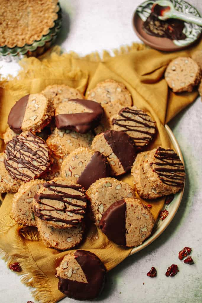 chocolate cookies on plate and yellow napkin