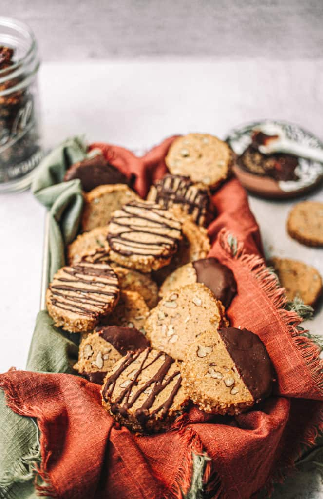 chocolate coated cookies with pink napkin