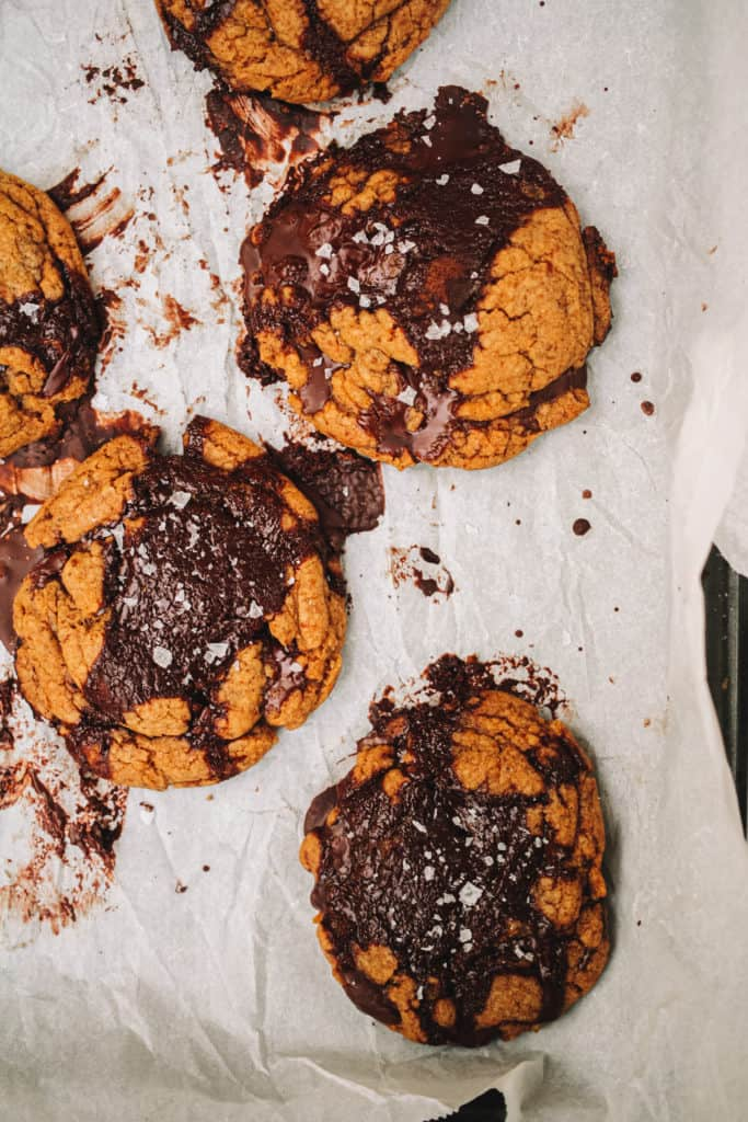 brown butter chocolate chip cookies out of the oven with melted chocolate
