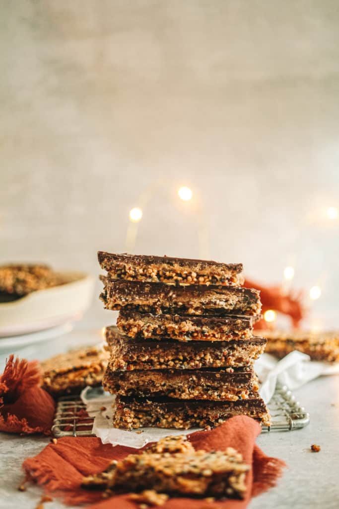 Matzo crack stacked with Christmas lights behind it