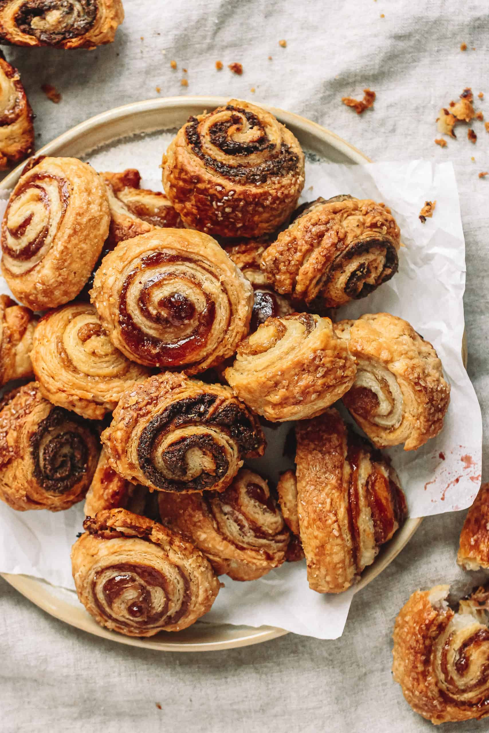 Vegan Rugelach is buttery and flaky with a crisp and airy pastry dough filled with raspberry jam, fig jam, and homemade poppyseed filling.
