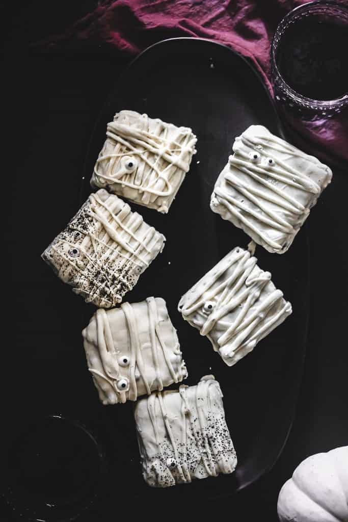white chocolate treats on black plate