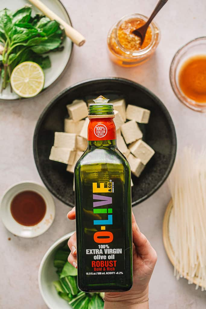 olive oil being poured over tofu.