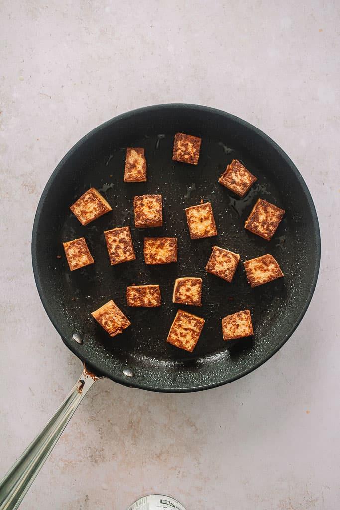 crispy tofu in a pan.